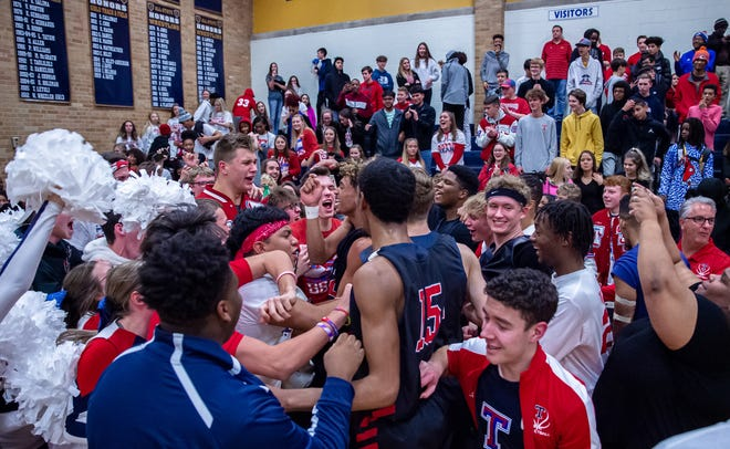 Scenes like this, when Truman fans celebrated a boys basketball win in 2019, will not be allowed in 2020 because of the COVID-19 pandemic and new social distancing and limited attendance guidelines issued by Eastern Jackson County school districts this week.