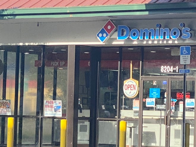 "This Domino's at 103rd Street and Old Middleburg Road and nearly 50 others throughout the Greater Jacksonville area are looking to hire about 700 team members, the company announced. A ""Now Hiring"" sign is displayed to the left of the entrance."