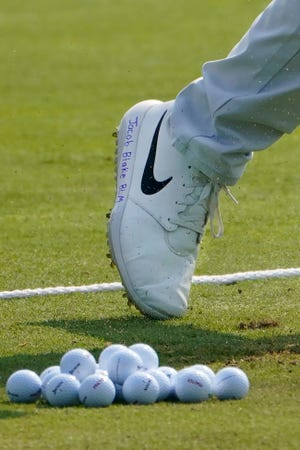"""Cameron Champ displays the message """"Jacob Blake BLM"""" on his shoe during Wednesday's practice round for the BMW Championship golf tournament at the Olympia Fields Country Club in Olympia Fields, Ill."""
