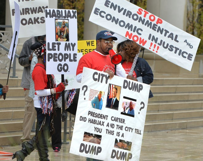 Neighbors organized by the Fairway Oaks Homeowners Association demonstrated outside the Duval County Courthouse in 2017 to call attention to their lawsuit claiming their homes were built on top of an old garbage dump without their knowledge. The suit said the foundation of homes had become  unstable and were sinking.