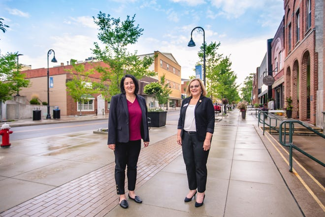 From left, Cuyahoga Falls Deputy Community Development Director Mary Spaugy and Community Development Director Diana Colavecchio are pictured on a sidewalk along Front Street. Colavecchio said businesses have created 22 new jobs and invested $1 million in project in the downtown so far this year.