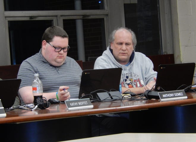 From left, Cuyahoga Falls Board of Education members Anthony Gomez and Dave Martin review information during a board meeting in 2019. Martin resigned from the board effective Aug. 11. The board will interview eight candidates who applied to replace Martin and select the new member on Sept. 2.