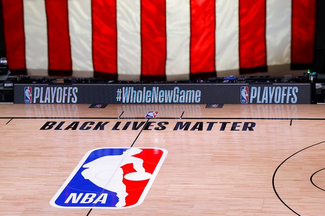 An empty court and bench are shown following the scheduled start time of Game 5 of an NBA basketball first-round playoff series Wednesday in Lake Buena Vista. All three NBA playoff games scheduled for Wednesday were postponed, with players around the league choosing to boycott in their strongest statement yet against racial injustice.
