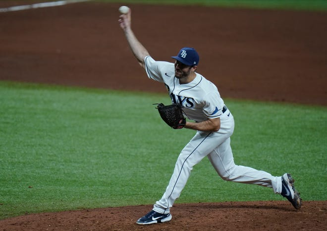 Tampa Bay Rays relief pitcher John Curtiss during the eighth inning of a baseball game against the Toronto Blue Jays last Saturday. CHRIS O'MEARA/THE ASSOCIATED PRESS