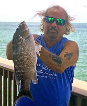 Warren Mickle, of Jefferson City, Tenn., caught this 20-inch mangrove snapper while fishing at Big Pier 60 in Clearwater this week. PROVIDED BY BIG PIER 60