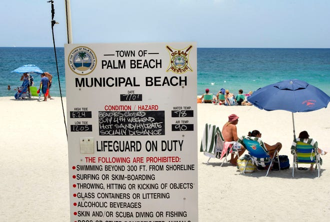 Swimmers and sunbathers enjoy Midtown Beach July 1. Midtown Beach reopened Thursday after being closed one day. [MEGHAN MCCARTHY/palmbeachdailynews.com]