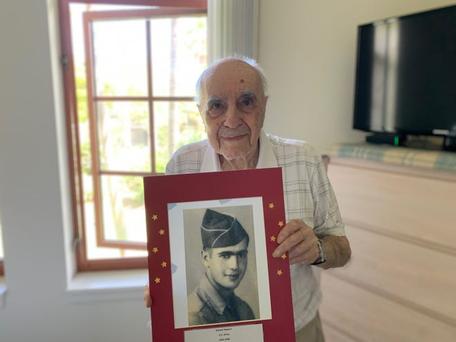 Gerard Halpern, a 95-year-old Palm Beach Gardens resident, poses with his U.S. Army photo from World War II. Halpern, who fled Germany with his parents at the age of 12, enlisted at age 18 after one semester of college in New York City. He was serving in France when the war ended in 1945. [Photo provided by Gerard Halpern]