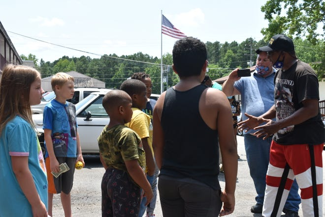 Muhammad Ali Jr. visits children at the American Inn in Petersburg in July 2020 while touring the city. A large number of kids have taken up long-term residences at the motel. Ali Jr. talks to the children about staying focused in school.