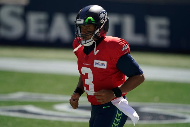 Seattle Seahawks quarterback Russell Wilson (3) during warmups before an NFL football mock game, Wednesday, Aug. 26, 2020, in Seattle. (AP Photo/Ted S. Warren)