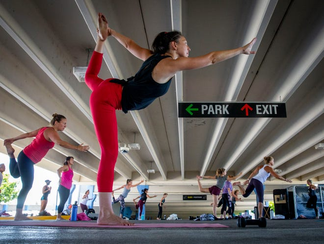 Liana Leung participates in the DAC Outdoors Warrior Rhythm class in the Overpark in Eugene. The classes are part of a Eugene city program that has enabled the DAC to use the covered structure.