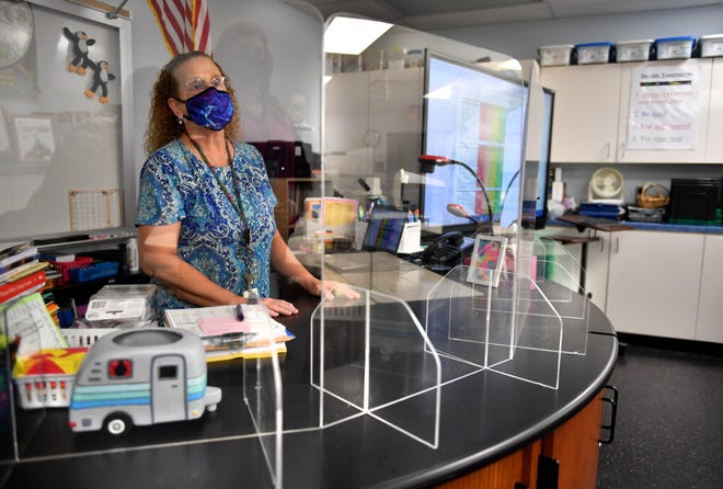 Science teacher Mary Ward has had plexiglass dividers installed on her desk and on the students' desks in her classroom. The plexiglass allows her to see all her students. Ashton Elementary staff and teachers are making final preparations for school to start on Monday, Aug. 31, 2020.