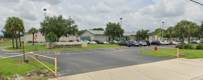 The principal of Kinnan Elementary School  has been put on administrative leave for coming to school while he awaited the results of a COVID-19 test.
