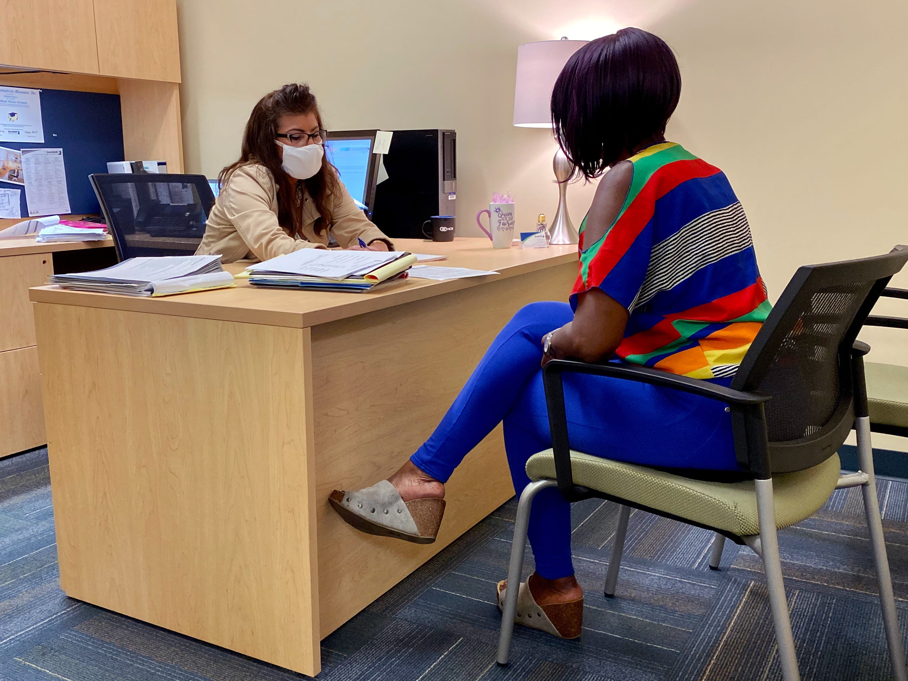 Digital instructor Yolanda Garcia, left, works with client Cherry Moore, 62, as part of a partnership between the Women's Resource Center and Goodwill Manasota.