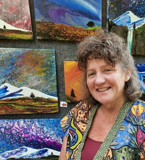 Catherine McElroy's art include whimsical watercolors, and more recently, fluid art pieces.