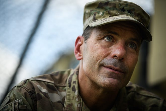 Maj. Gen. Christopher Donahue, the new 82nd Airborne Division commanding general, talks to a reporter during an exercise on Fort Bragg on Wednesday. 'It is absolutely the most enjoyable, rewarding and best job I've ever had, hands down,' he said.
