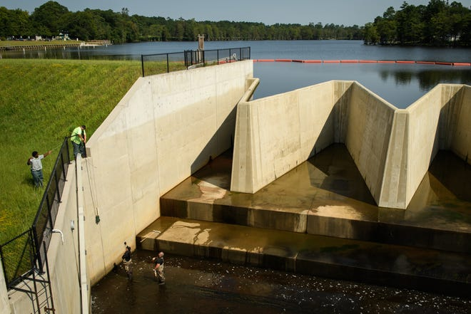 The water at Hope Mills Lake was slightly lowered so the dam could be checked for possible earthquake damage on Thursday.