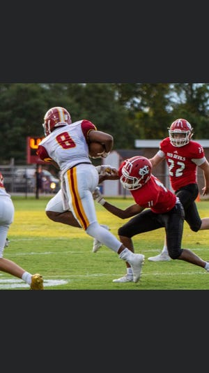 Hickory's Rico Walker (8) made 23 tackles and seven sacks in just three varsity games last season. (Photo courtesy of Rico Walker)