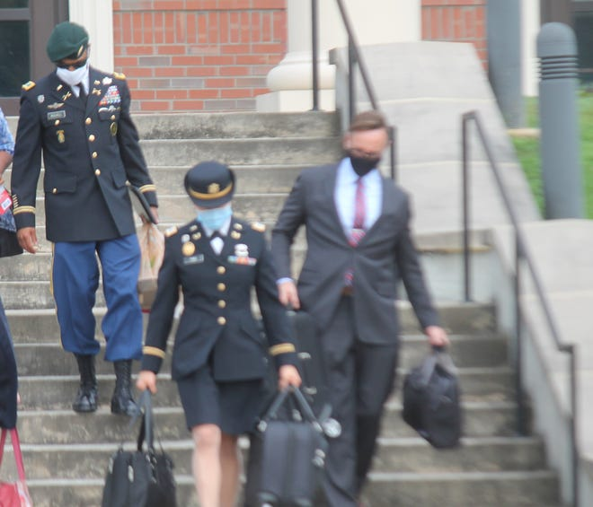 Col. Kevin M. Russell leaves the Fort Bragg Courthouse building Thursday, Aug. 27, 2020, behind his defense attorneys Capt. Iris Yao and Michael Waddington, after being found not guilty of sexual assault charges that he faced.