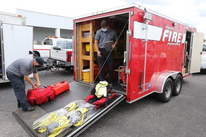 Jason Bryant and Derrick Riddle show specialized water rescue equipment to the media as Tuscaloosa Fire Rescue Service is standing by to deploy a water rescue team to help in the aftermath of Hurricane Laura Thursday, August 27, 2020. [Staff Photo/Gary Cosby Jr.]