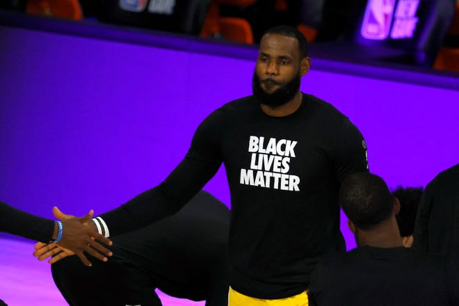 Los Angeles Lakers' LeBron James kneels during the national anthem prior to a game against the Oklahoma City Thunder on Wednesday, Aug. 5, 2020, in Lake Buena Vista, Fla.