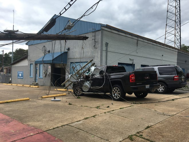 A utility pole snapped and damaged two vehicles at the Pineville Public Works Compound during Hurricane Laura Thursday.