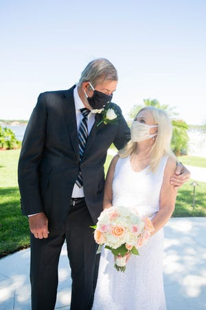 Tim Meadows and Arlene White-Meadows held a small wedding ceremony at their Ormond Beach home in May, wearing masks to prevent the spread of COVID-19. Melbourne-based Kayla Huston planned the event.