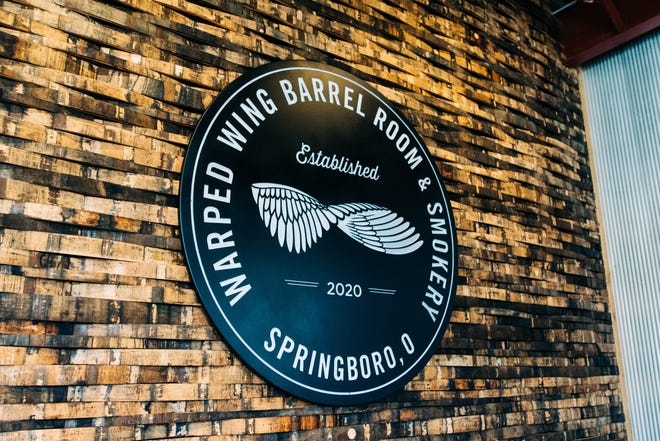 Dayton-based Warped Wing Brewing Company is opening a Barrel Room & Smokery in downtown Springboro. It will open officially Aug. 29.