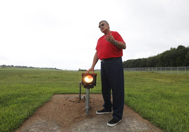 Richard Downing Airport Administrator Bethel Toler explains the precision approach path indicator lights at the airport. The lights help pilots land safely, showing a certain combination of lights that tell a pilot if they are too high or too low to land safely, or at the right angle for a safe landing.