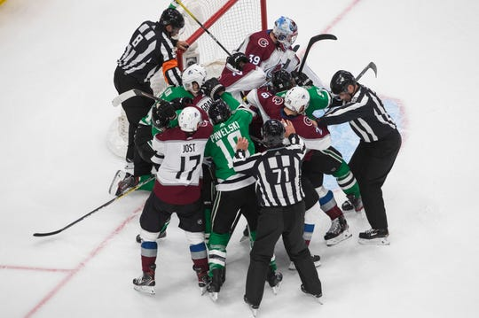 Dallas Stars and the Colorado Avalanche players rough it up during the third period of Game 3 of an NHL hockey second-round playoff series, Wednesday, Aug. 26, 2020, in Edmonton, Alberta.