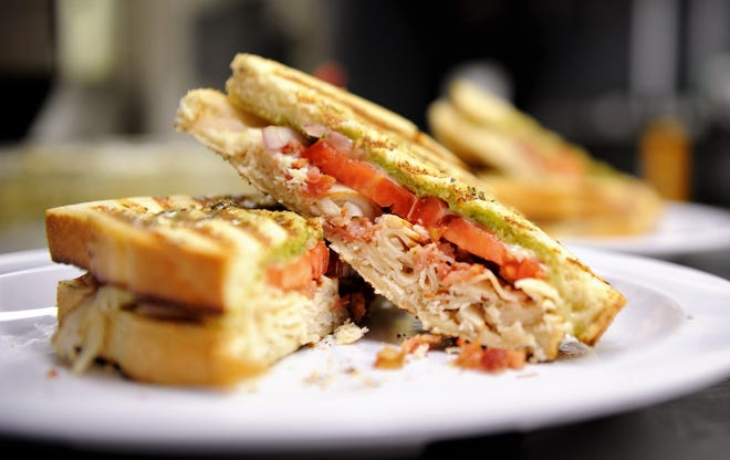 A Cluckin Pig panini sandwich with chicken, roasted tomato and pesto at Dontae's Highland Pizza Parlor on Wednesday afternoon, Aug. 27, 2020.