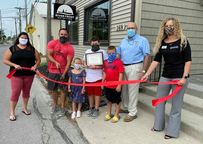 Riverfront Nutrition held a ribbon cutting in Oak Harbor on Aug. 26. Left to right are Valerie Winterfield, Oak Harbor Chamber of Commerce;  Mike Lento, Owner of Riverfront Nutrition;, Addie, Eddie and Jax Lento; Don Douglas, Ottawa County Commissioner; and Jill Kozlok,Commodore Perry Federal Credit Union