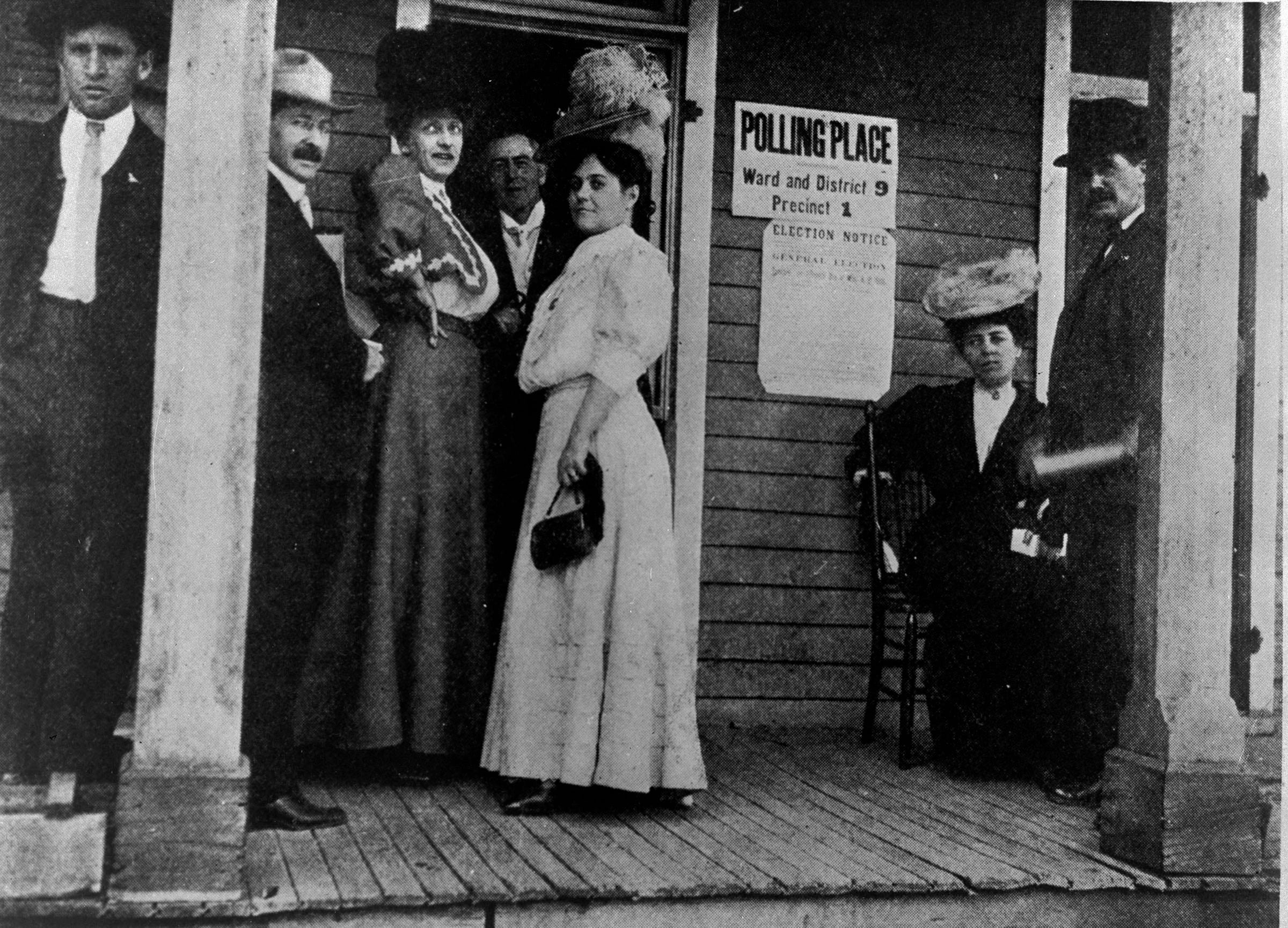 Women stand outside of a Colorado polling place in this undated historic photo.