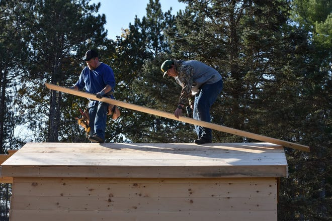 Workers construct a tiny home for transitional housing on the Menominee reservation.