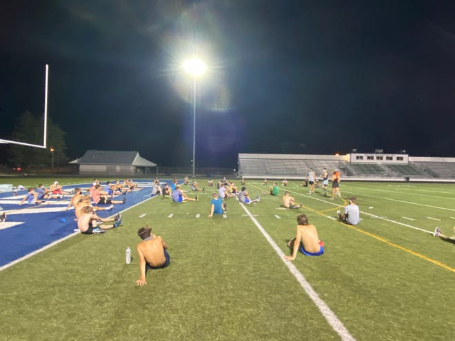 The Green Bay Notre Dame cross-country team prepares for practice on Wednesday night. The first meet of the season is Friday.