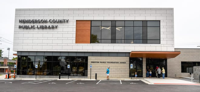 People arrive for the reopening of the Henderson County Public Library, closed for more than five months due to pandemic and construction Thursday, August 27, 2020.
