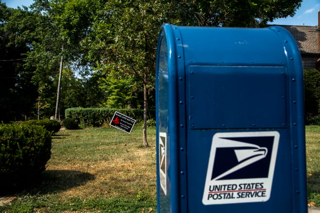 "A sign in a yard reads, ""Black Lives Matter,"" next to a United States Postal Service (USPS) blue mail box, Tuesday, Aug. 25, 2020, on the corner of Bowery and Summit Streets in Iowa City, Iowa."