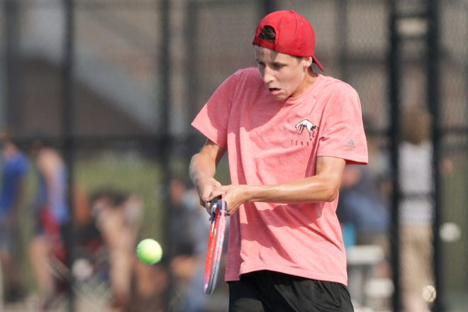Lafayette Jeff's Dylan Cornell hits the ball during an IHSAA tennis match against Central Catholic's Griffin Chyall, Wednesday, Aug. 26, 2020 in Lafayette.