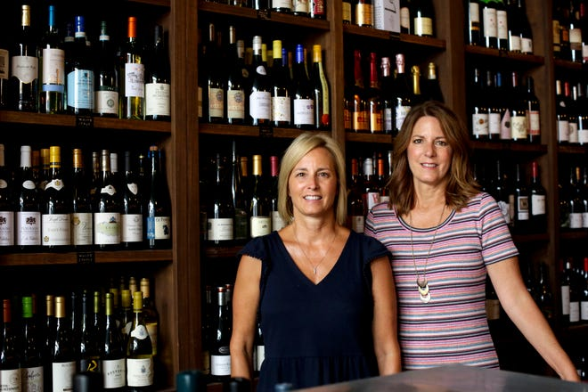 Michelle Wise, left, and Marla Milner, co-owners of The Cellar Wine Bistro, Thursday, Aug. 27, 2020 in Lafayette.