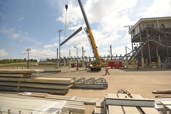 A portion of the grandstands of Mansfield Motor Speedway are dismantled Thursday morning.