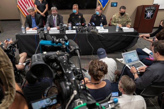 Police and law enforcement leaders speak at a news conference Wednesday at the Kenosha Public Safety Building.