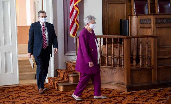 Gov. Kay Ivey and state health officer Dr. Scott Harris during a coronavirus press conference at the Alabama State Capitol in Montgomery, Ala., on Thursday, Aug. 27, 2020.