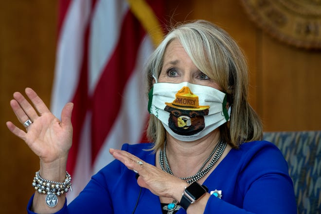 Governor Michelle Lujan Grisham, wearing a Smokey Bear mask provided by someone with the National Forest Service, gives her update on the COVID-19 outbreak in New Mexico and the state's effort to deal with it. The news conference was held at the Roundhouse in Santa Fe, Thursday August 27, 2020.