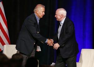Joe Biden and John McCain shake hands after their conversation at the McCain Institute's 2013 Sedona Forum on April 26, 2013, in Sedona.
