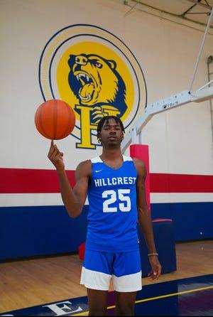 Hillcrest Prep boys basketball forward Jamiya Neal spins a basketball on his finger in the team's gymnasium.