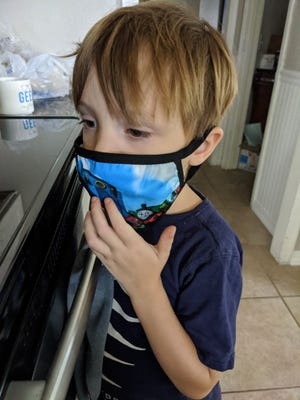 Jack Griffith, 5, wearing a face mask.