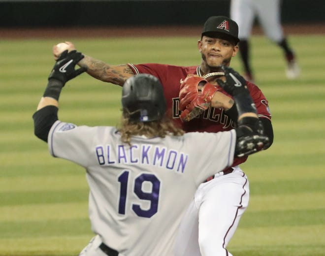 Aug 26, 2020; Phoenix, Arizona, USA; Arizona Diamondbacks second baseman Ketel Marte (4) throws to first after forcing out Colorado Rockies' Charlie Blackmon (19) at second during the fifth inning at Chase Field. The Arizona Diamondbacks did not turn a double play. Mandatory Credit: Michael Chow-USA TODAY Sports
