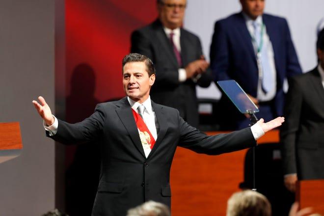 El expresidente de México, Enrique Peña Nieto, presenta el sexto y último informe de su gobierno, el lunes 3 de septiembre de 2018, en el Palacio Nacional, sede del Ejecutivo, en Ciudad de México.