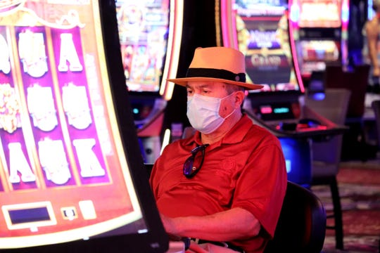 Some gamblers spent the first hour of the Mirage reopening playing slots on Aug. 27, 2020.