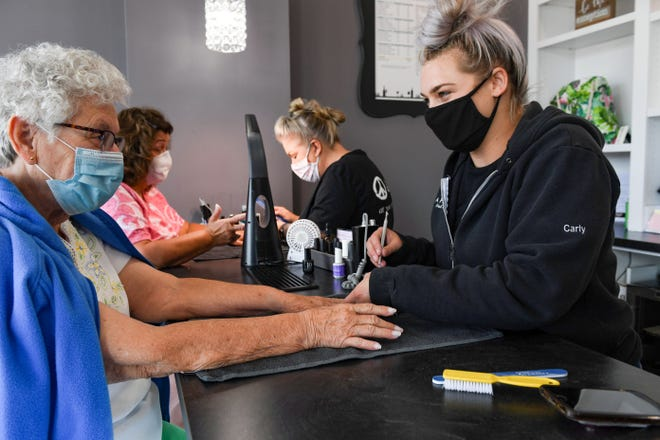 Nail technician Carly McComsey, right, chats with Vonnie Cox as she works on her nails on Thursday, August 27, at Perfect 10 Nail and Beauty Bar in Sioux Falls. Technician Carrie Melow works with Tammy Browne beside them.