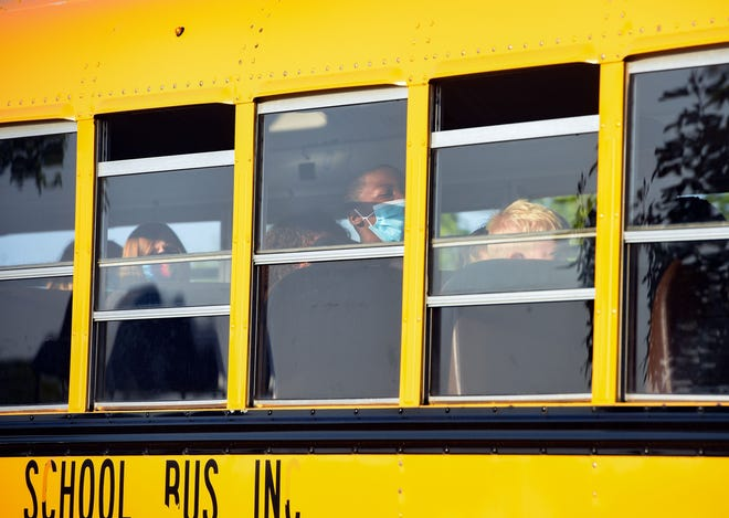 Students arrive for the first day of school on Thursday, August 27, at Discovery Elementary School in Sioux Falls.